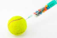 A syringe injecting colourful pretend drugs into a tennis ball